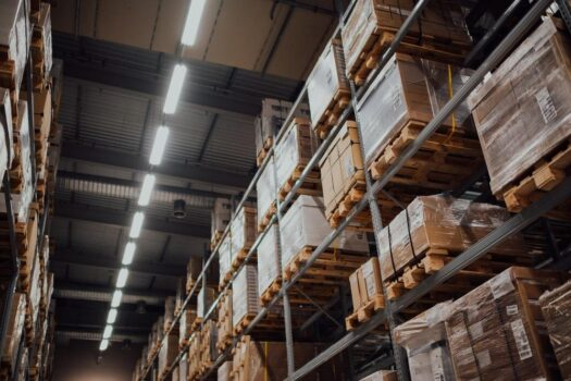 a warehouse stocked with items on shelves